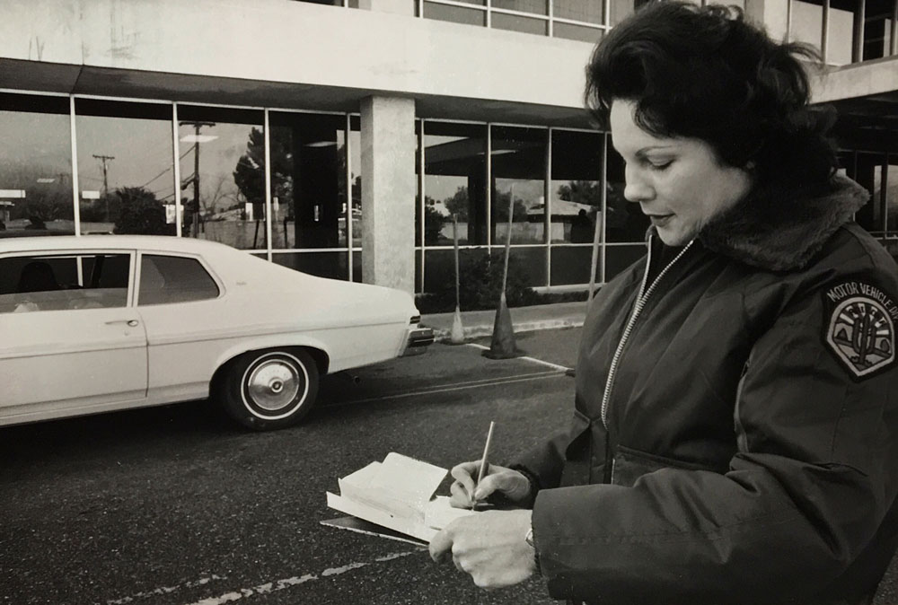An MVD driver license examiner conducts a road test at the Encanto Office Jan. 26, 1979