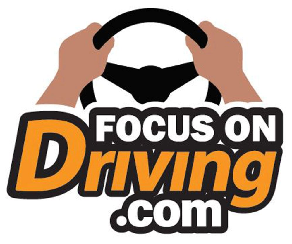 Hands on a steering wheel - Focus on Driving.com