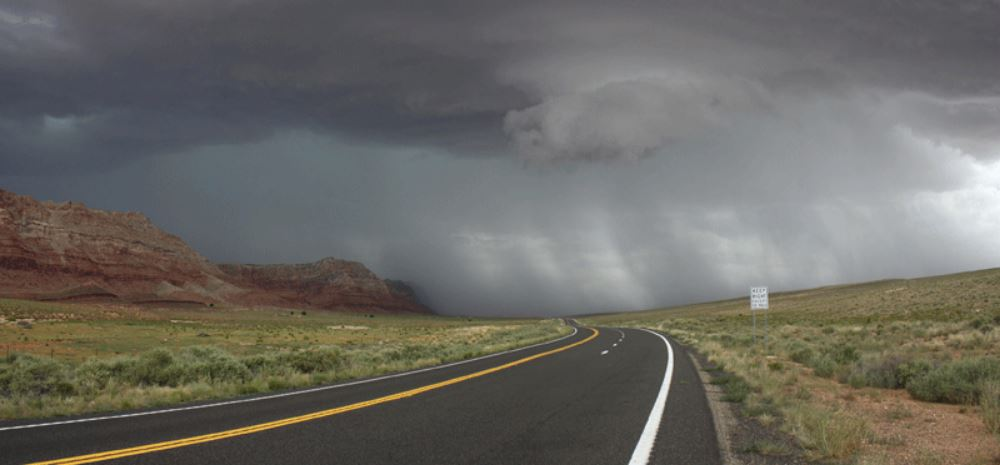 Roadway leading into a storm front