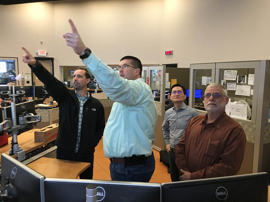 A team from the North Texas Tollway Authority visits ADOT's Traffic Operations Center to view the I-17 wrong-way vehicle alert system.