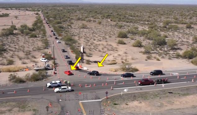 Aerial view of the US 60 lined with traffic cones up to entrance to Renaissance Festival.