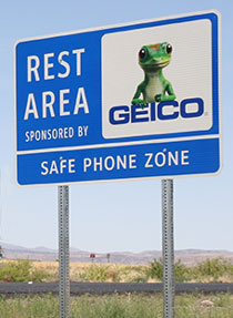 Road Sign: Rest Area Sponsored by Geico - Safe Phone Zone