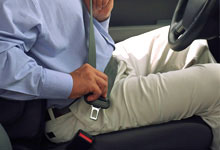 Man putting on seat belt