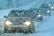 Cars driving during snowstorm