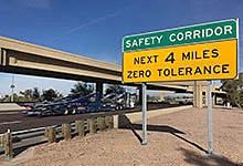 Safety Corridors signs nears freeway overpass