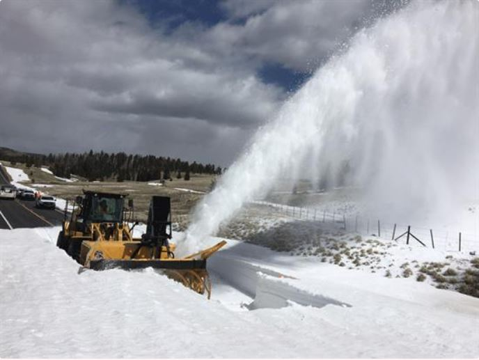 Snowblower clears snow from State Route 273