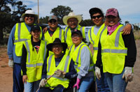 Group of Adopt a Highway volunteers wearing safety vests