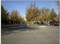 Example of Three Lane Raised Median; Courtesy of FHWA