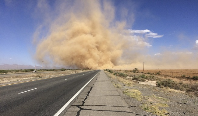 Photo of blowing dust along highway