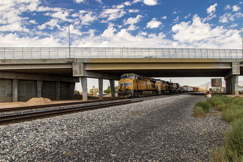State Route 347 bridge in Maricopa with train running underneath