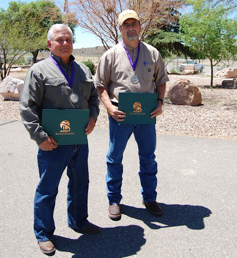 Frank Gidney and Lonnie Baca receive awards for their heroic efforts.