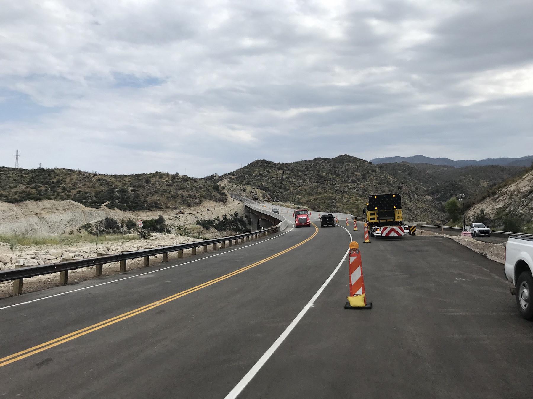 Photo of traffic using new Pinto Creek bridge on US 60