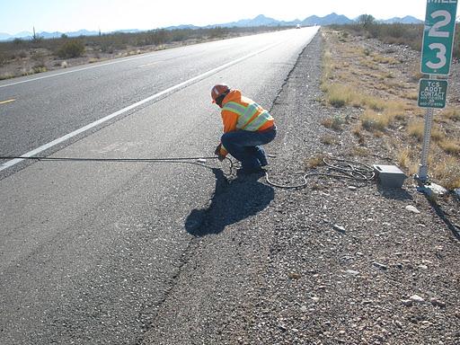 Technician Placing Pneumatic Road Tubes