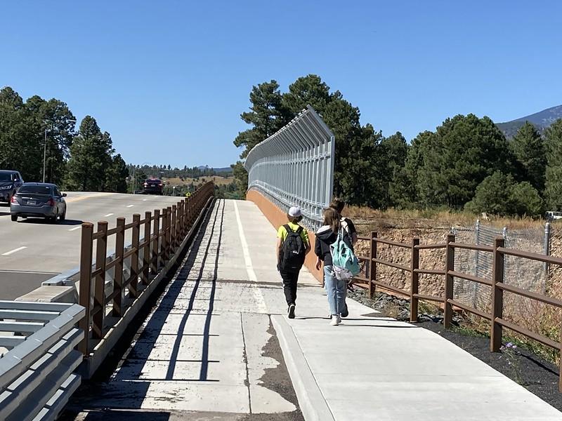 Students using Fourth St Bridge