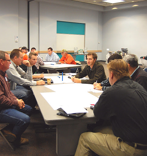 City officials, utility company representatives, designers, contractors and, of course, ADOT meet to discuss project.