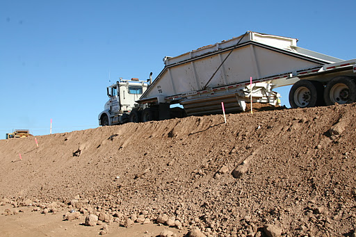 Belly Dump Truck Transporting Dirt