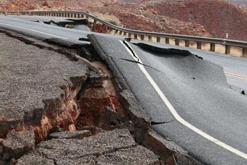 Buckled pavement on US 89 after landslide