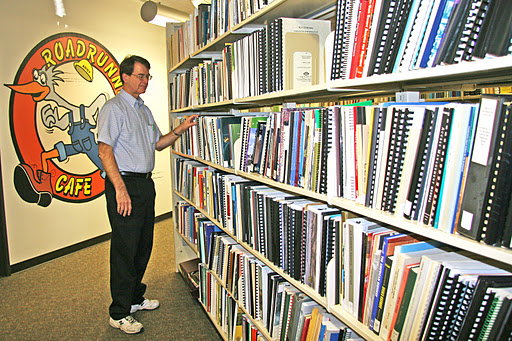 Librarian Dale Steele checks out the ADOT Research Library shelves.