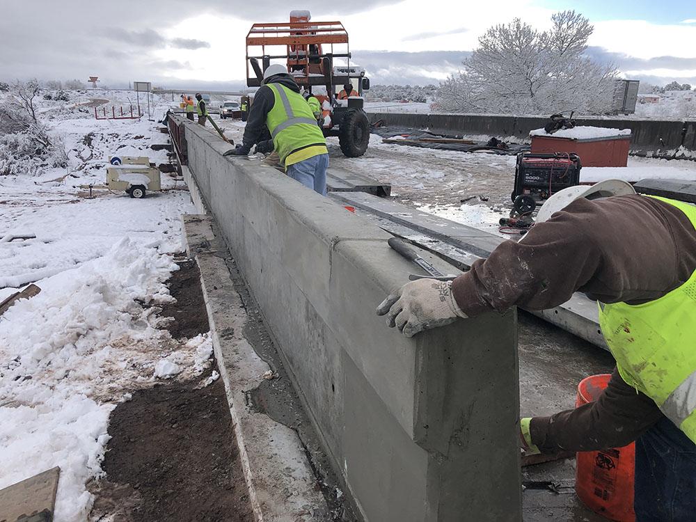 Workers constructing new bridge deck on the St. Anselm bridge
