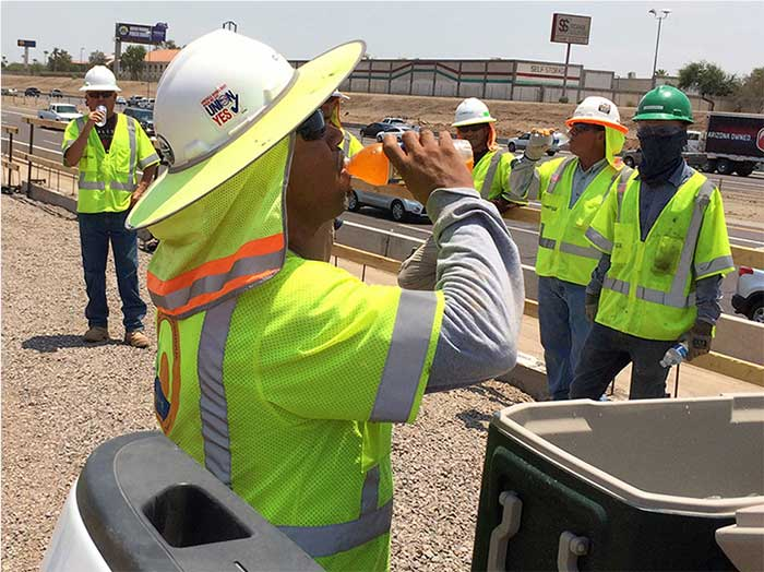 ADOT workers re-hydrating on a hot day