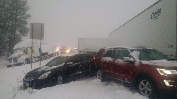 Cars and Trucks at snowy accident scene