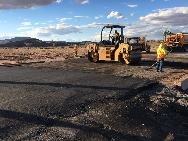 Smoothing US 89 after flood damage.