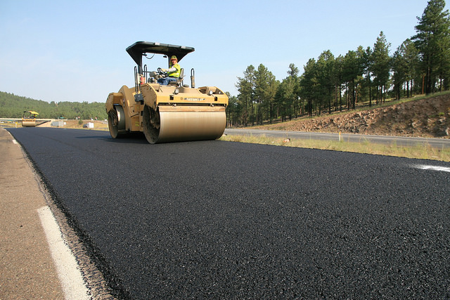Smoothing new pavement west of Flagstaff.