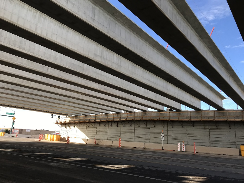 Girders in place for 32nd Street bridge over the South Mountain Freeway from below.