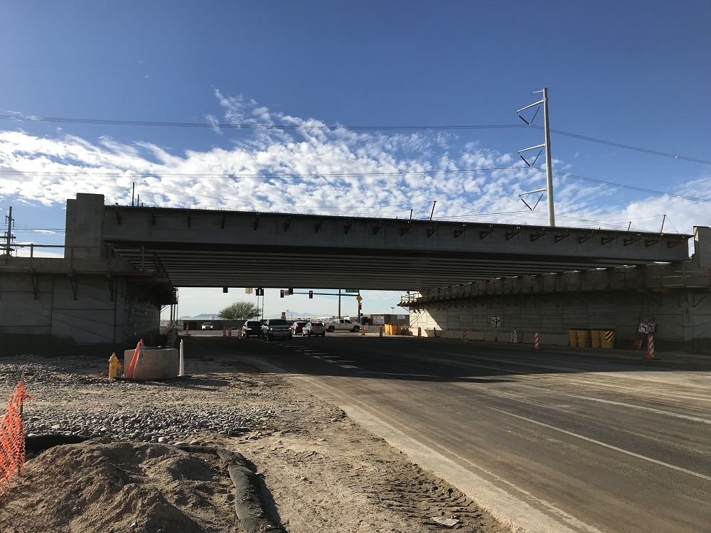 Side view of girders in place for 32nd Street bridge over the South Mountain Freeway.