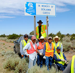 Adopt a Highway clean up crew and sign