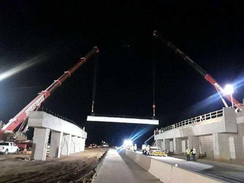 South Mountain Freeway Project: Cranes installing support beams on bridge in Laveen Area