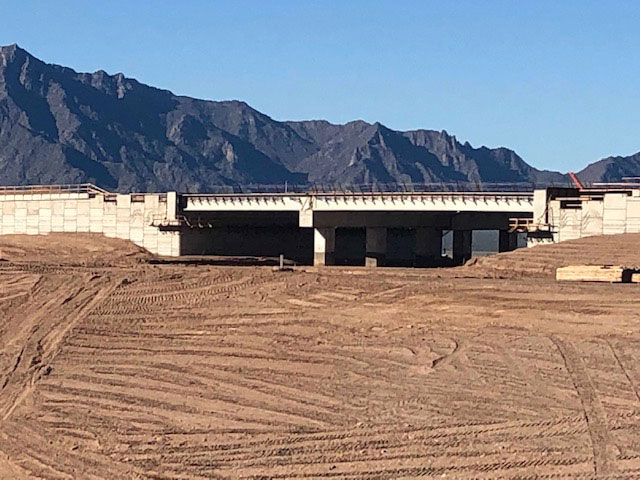 South Mountain Freeway Project: Side view of the Dobbins Rd. Interchange with Mountains in the Distance
