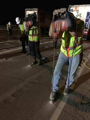 Workers Drilling holes on Loop 101