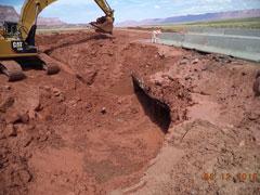 Excavator working on US 89A box culvert damage