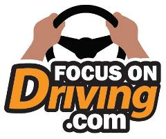 FocusOnDriving.Com Logo - hands at 10 and 2 on steering wheel