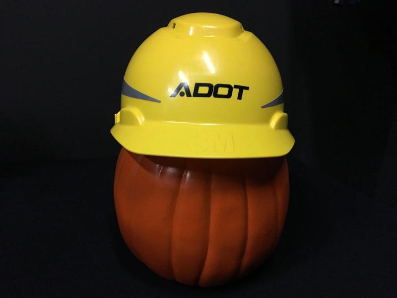 Pumpkin wearing an ADOT hard hat.