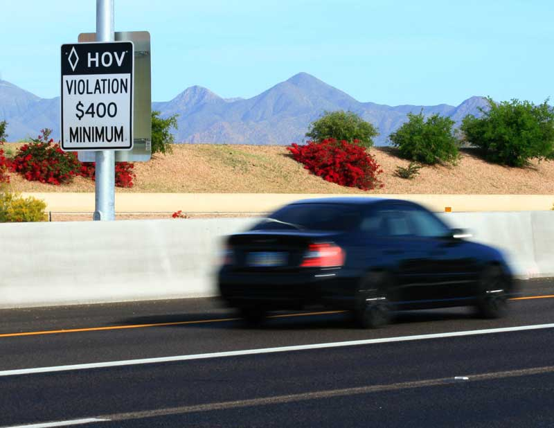 HOV Sign on Freeway - Violation $400 Minimum - as car goes by...