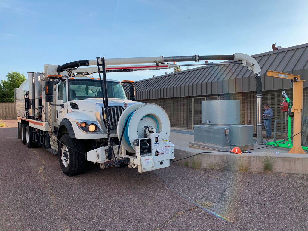 Hydrovac truck vacuums trash from an ADOT pump station - June 12, 2019