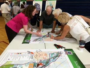 Involvement at I-11 Study Public Meeting in Marana - People reviewing corridor maps