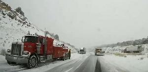 Trucks and snowplow on I-40 EB at Ashfork Hill