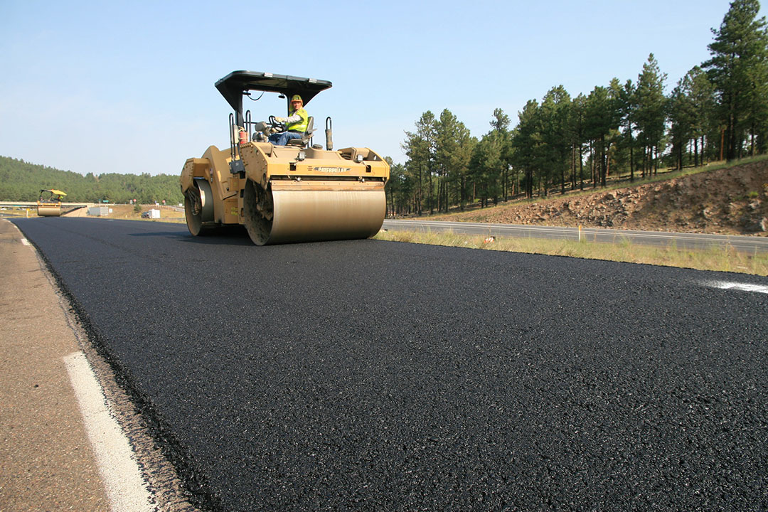 Crews paving on I-40 between Parks and Riordan