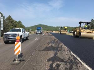 Paving work along I-40 as traffic passes