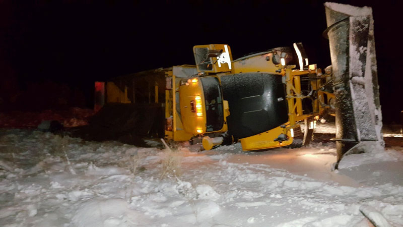 ADOT Snowplow on its side after crash on I-40 near Seligman