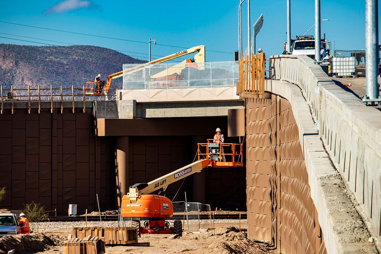 Worker in bucket truck under new ramp which takes traffic over train tracks - Ina Road, Feb. 1, 2109