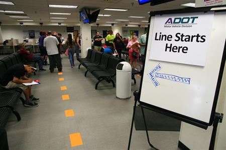 People stand in line at MVD office, testing proposed process improvements