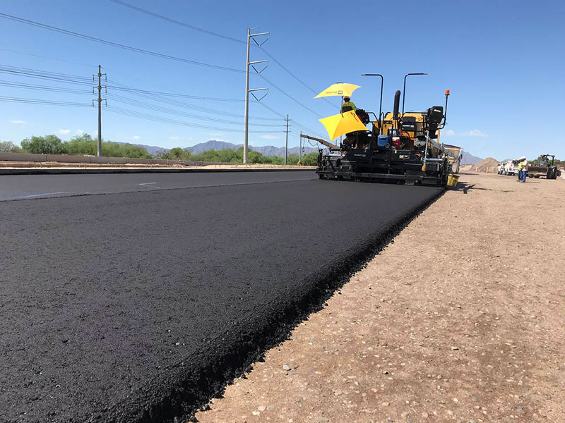 South Mountain Freeway Project: Freshly lain pavement on Pecos Rd.
