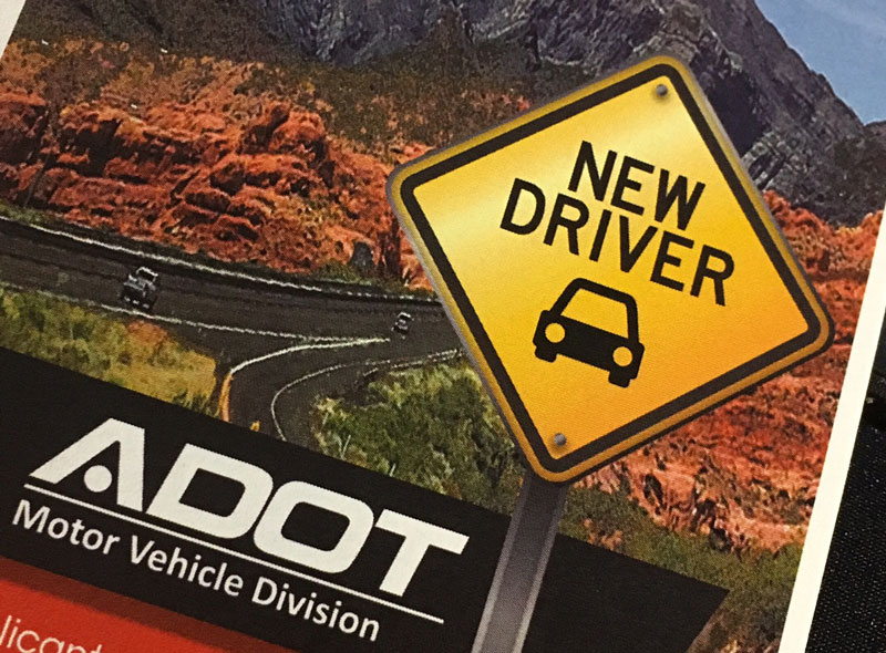 Portion of the Driver Manual Cover including Arizona Highway and New Driver Sign