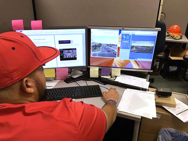 Staff remotely monitoring traffic conditions