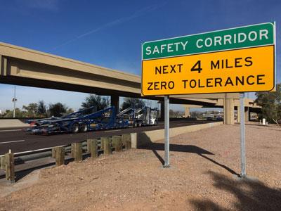 Safety Corridor Sign along highway: Safety Corridor, Next 4 Miles Zero Tolerance
