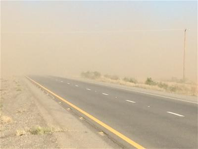 Blowing dust on highway in San Simon